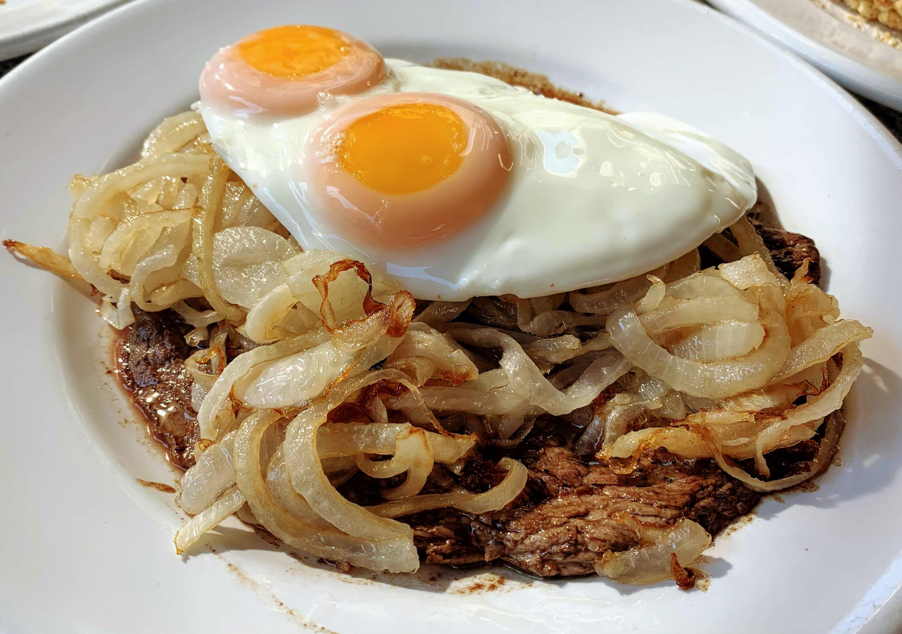 bife al caballo, traditional paraguayan breakfast dish